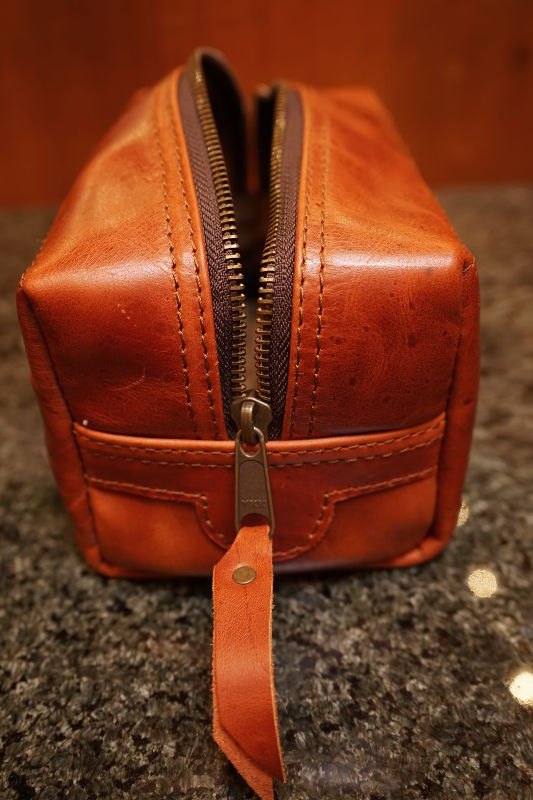 Real Leather Hoi An - Da Bao Real Leather: Front view of brown toiletry bag showing Ykk zipper.